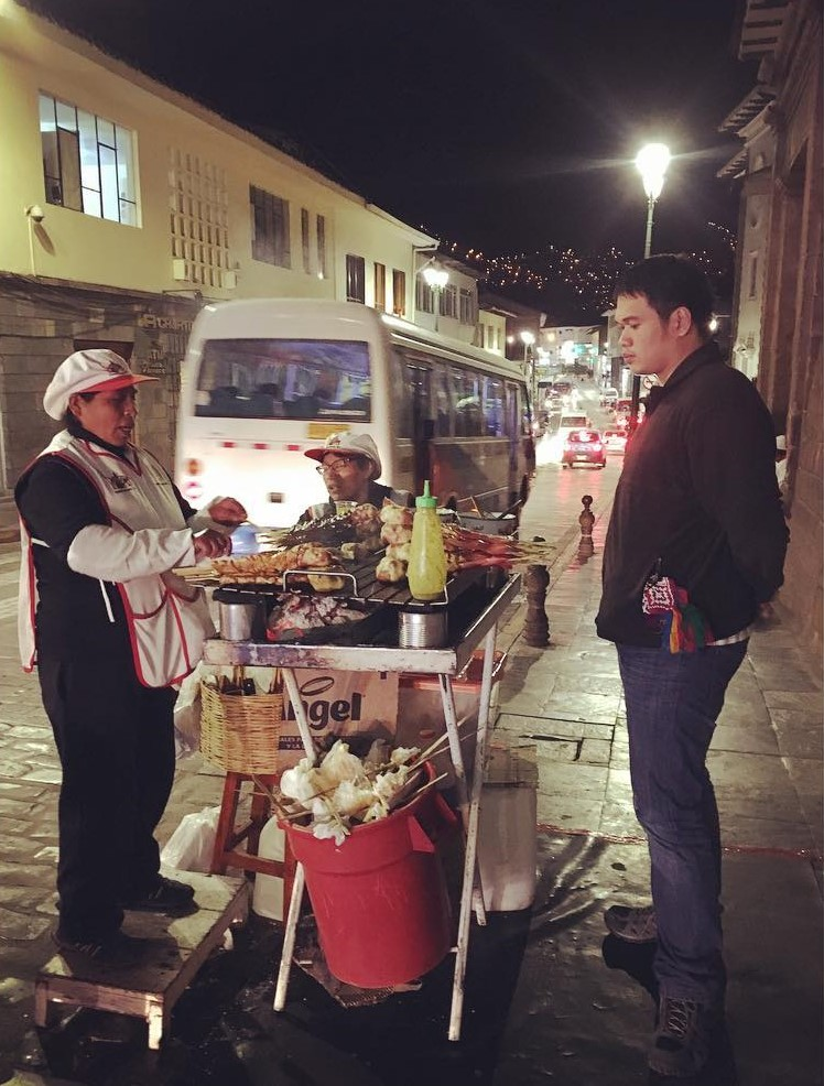 Photo by: @kristenaci0us Meat and chicken anticuchos at Cusco streets