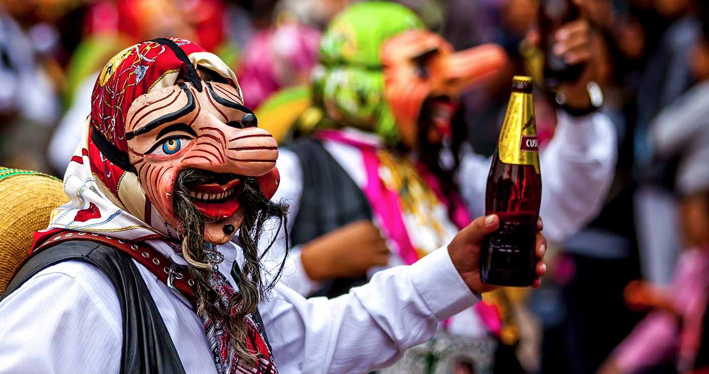 Man with a mask and a beer