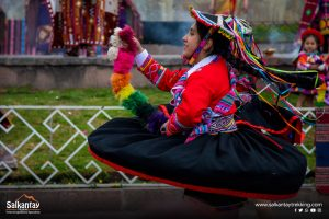 Girl dancing in traditional andean outfit