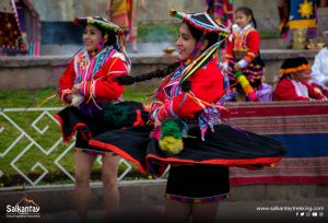 Girls dancing at ceremony to Pachamama
