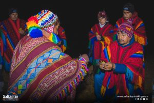 Andean priest and people in ceremony to the Pachamama