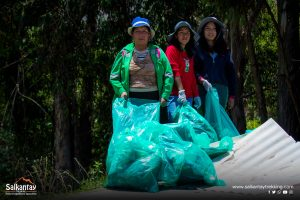 Women picking up trash at cleaning campaign