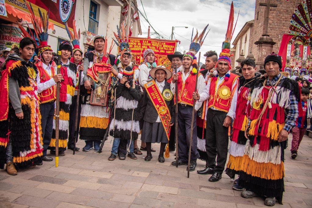 People in traditional dresing at San Sebastian Cusco