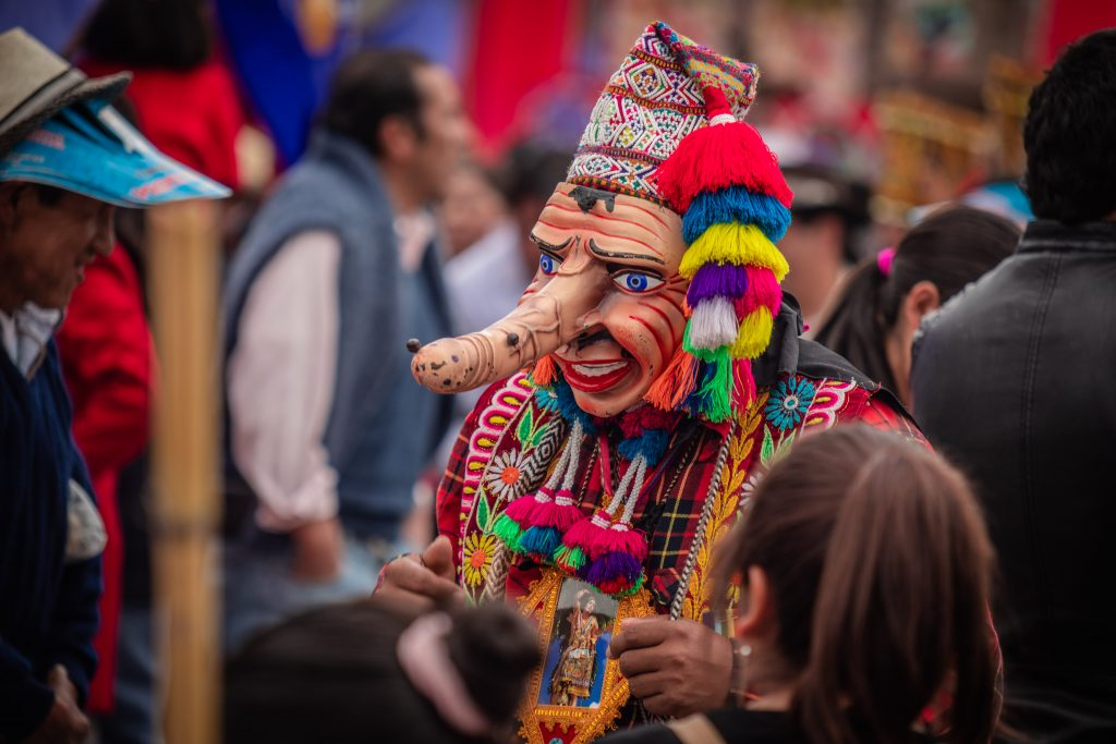 Man with mask in San Sebastian Cusco