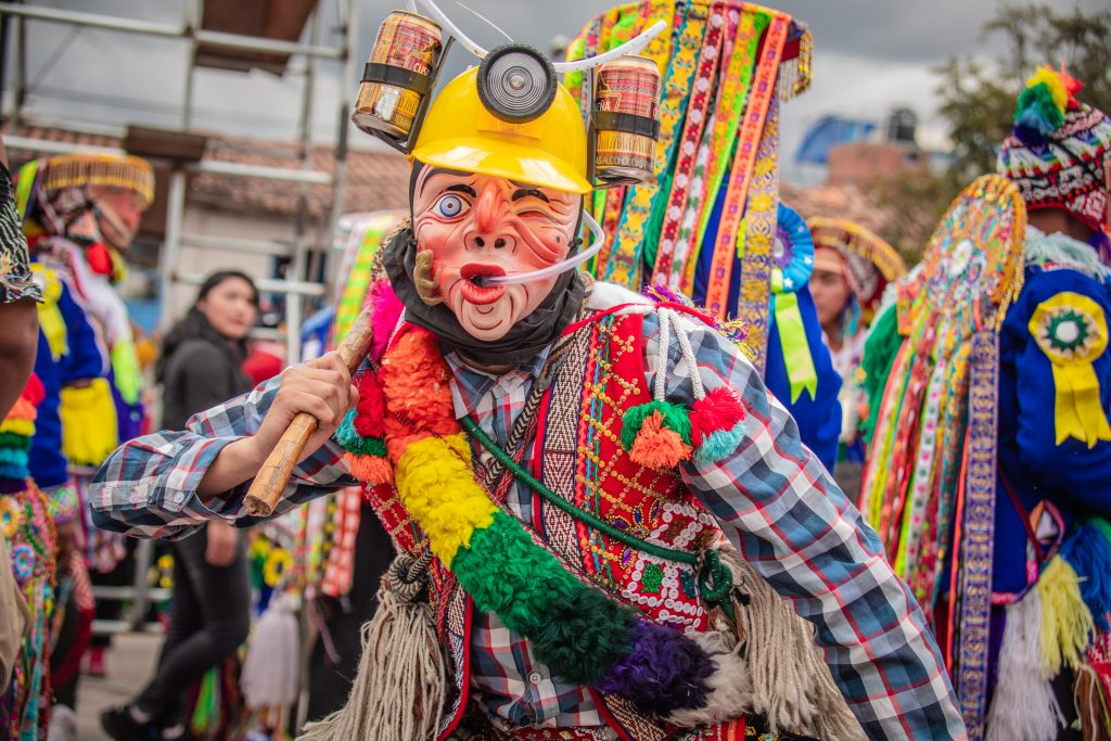 Man with mask in San Sebastian Cusco