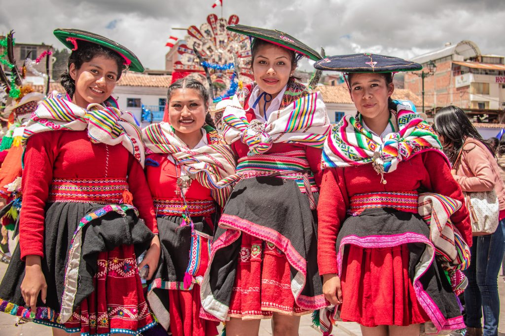 Women in traditional dress in Cusco San Sebastian