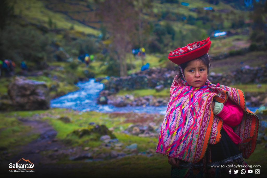 Girl wearing sophisticated textiles at Lares trail