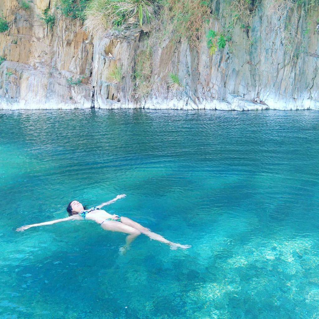 Woman swimming at hot spring