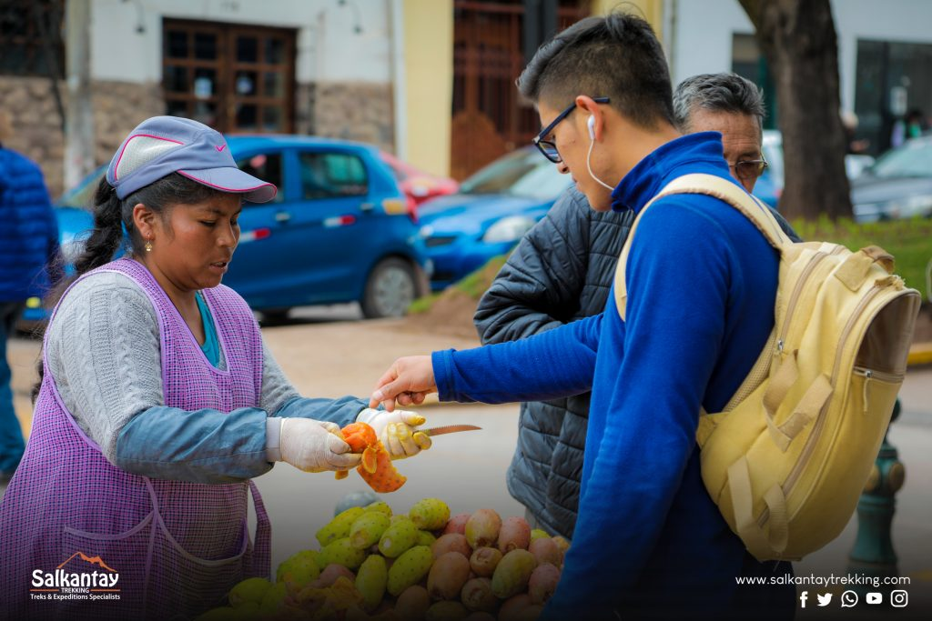 Woman selling fruit to a guy