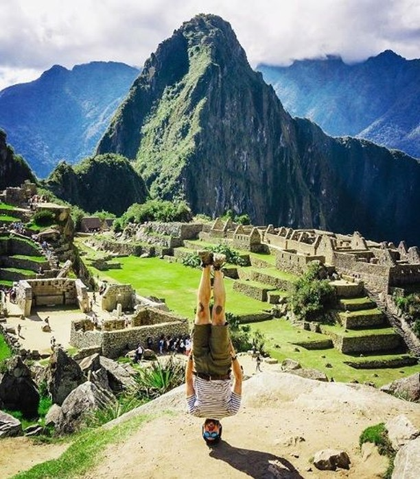 Man upside down at Machu Picchu