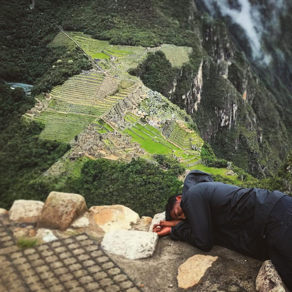 Man resting on Wayna Picchu's top