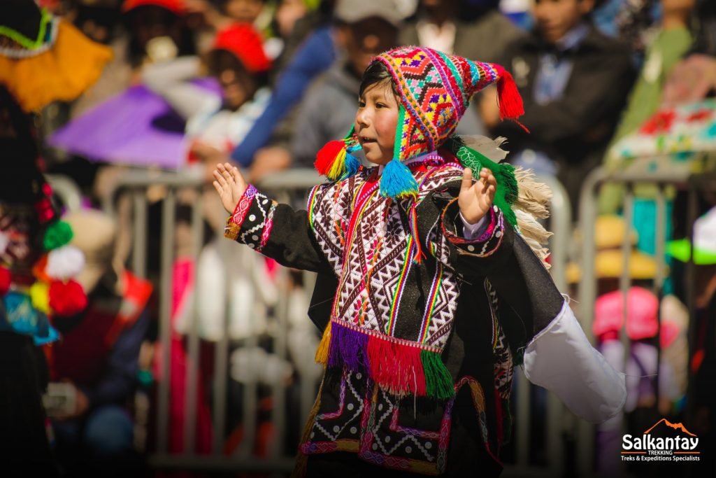 Boy dancing on traditional outfit in Cusco
