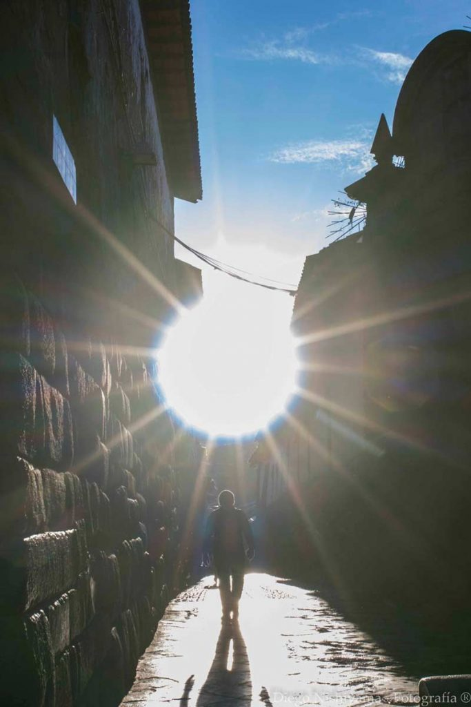 The sun illuminating the streets of Cusco