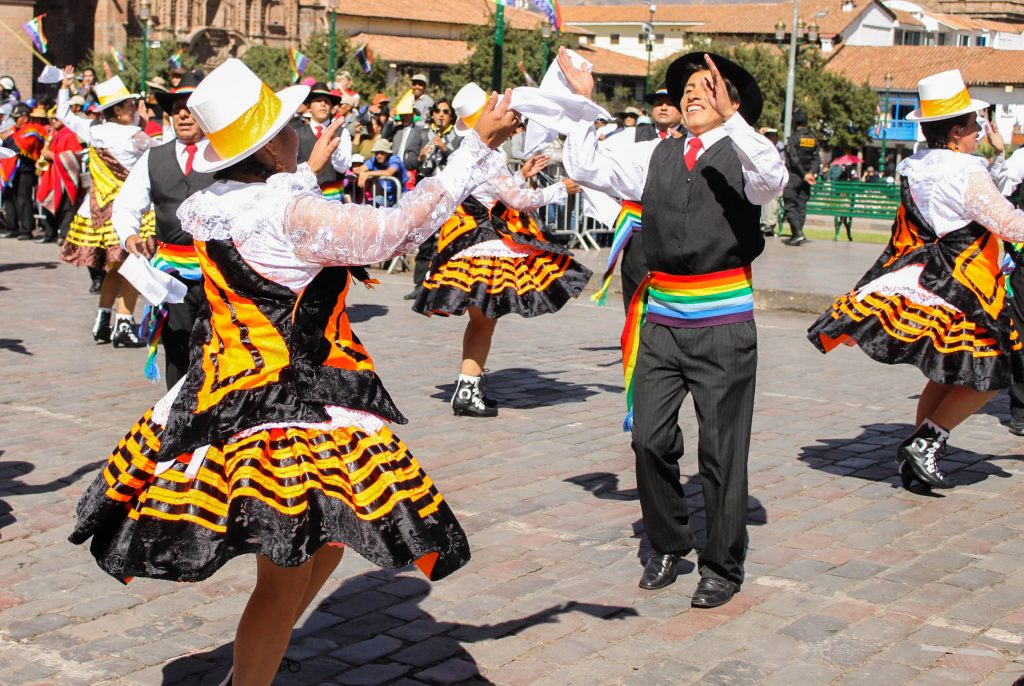 Couples bring happiness and elegance to Cuzco festivities.