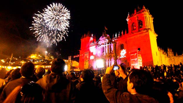 plaza-is-full-to-brim-people-fireworks-set-off-city