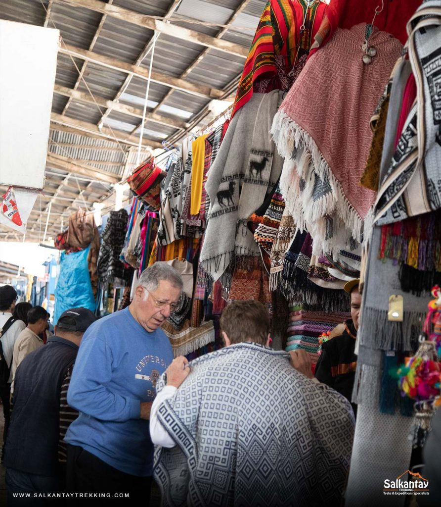 Tourists buying handicrafts in the San Pedro market of Cusco