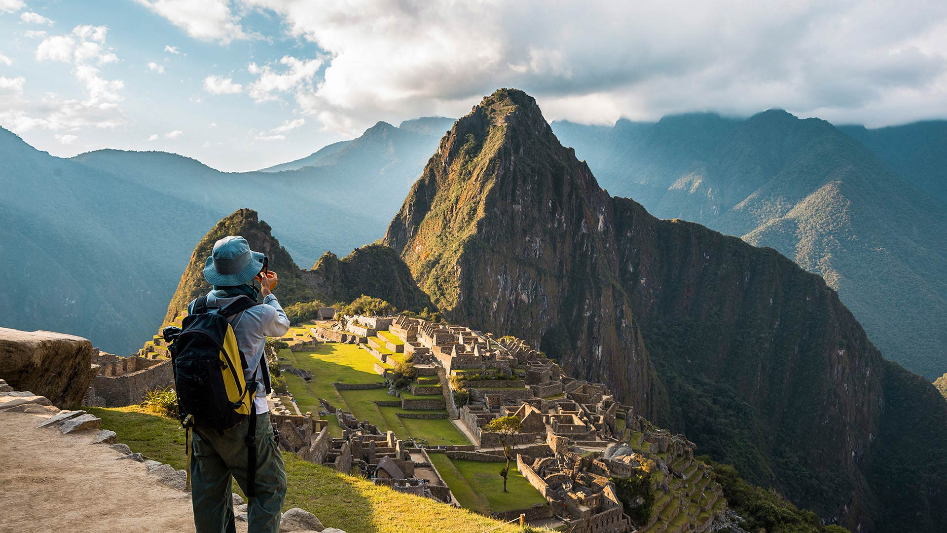 Tourist taking a photo to Machu Picchu wonder of the world
