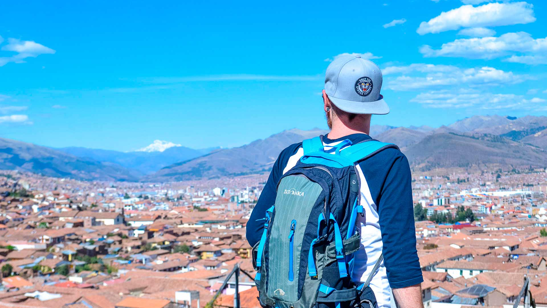 Tourist with a panoramic view of the city of Cusco